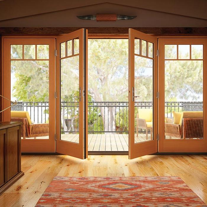 French doors open to a second story veranda